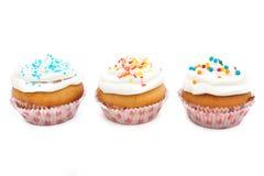 Cupcakes, muffins met bestrooit Royalty-vrije Stock Afbeeldingen