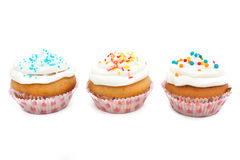 Cupcakes, muffins with sprinkles royalty free stock images