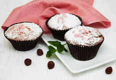 Cupcakes and nuts. On a old white wooden background Stock Photography