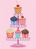 Cupcakes op een tribune Stock Foto's