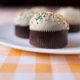 Cupcakes. On a orange tartan tablecloth Royalty Free Stock Image