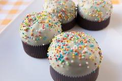 Cupcakes. On a orange tartan tablecloth Royalty Free Stock Photography