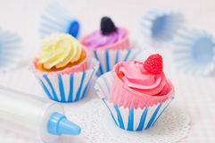 Cupcakes and paper molds Royalty Free Stock Images