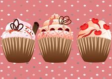 Cupcakes on the pink background Royalty Free Stock Photography