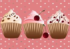 Cupcakes on the pink background Royalty Free Stock Image