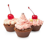Cupcakes with pink cream and cherry Royalty Free Stock Photo
