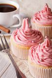 Cupcakes with pink cream and coffee close-up, vertical Stock Photo