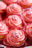 Cupcakes with pink fondant icing Stock Images