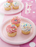 Cupcakes with pink icing Royalty Free Stock Photos