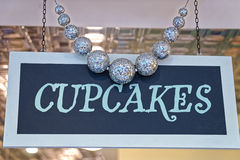 Cupcakes plate with decorating silver balls Royalty Free Stock Photo