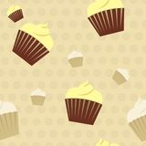 Cupcakes on a polkadot background seamless pattern. Adorable pastel coloured seamless pattern with chocolate and lemon and vanilla cupcakes on a beige polkadot Stock Photo