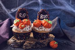 Cupcakes with pumpkins. For Halloween party royalty free stock images