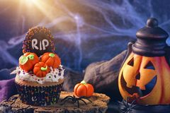Cupcakes with pumpkins. For Halloween party stock photography