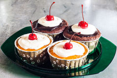 Cupcakes with red cherry Stock Image