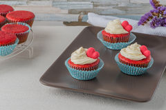 Cupcakes with red heart Stock Images