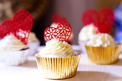 Cupcakes with hearts for Valentine`s day royalty free stock photos