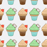 Cupcakes seamless background Royalty Free Stock Photos
