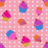 Cupcakes seamless. Cute cupcakes seamless with polka dots background Royalty Free Stock Image