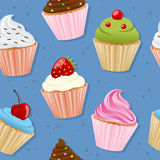 Cupcakes Seamless Pattern. A seamless pattern with colorful sweet cupcakes on blue background. Useful also as design element for texture, pattern or gift Royalty Free Stock Photos