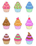 Cupcakes set. Set of nine sweet cupcakes isolated on white Royalty Free Stock Photos