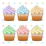 Cupcakes. Set of cakes with color whipped cream Stock Images