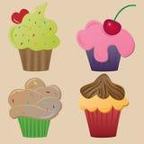 Cupcakes. Set of four cupcake on yellow background Royalty Free Stock Photos
