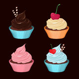 Cupcakes. Set of vector tasty cupcakes with cream. Royalty Free Stock Images