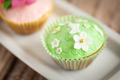 Cupcakes. Shabby chic cupcakes decorated with sugarpaste flowers Stock Image