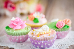 Cupcakes. Shabby chic cupcakes decorated with sugarpaste flowers and figures Royalty Free Stock Photos