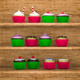 Cupcakes shelf. Several cupcakes on wooden shelf Stock Images
