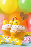 Cupcakes with smiley candles. And colorful balloons Stock Photos