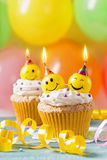Cupcakes with smiley candles Royalty Free Stock Image