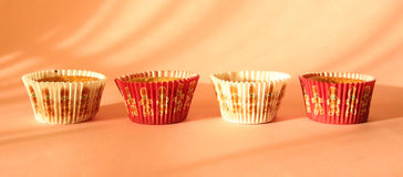 Cupcakes. Some cupcakes on pink background royalty free stock photography