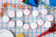 Cupcakes spell out happy birthday Royalty Free Stock Photography