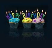 Cupcakes spelling out happy birthday Royalty Free Stock Images