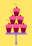 Cupcakes stack. Pink cupcakes with cherry in stack on plate. Party sweets Stock Image