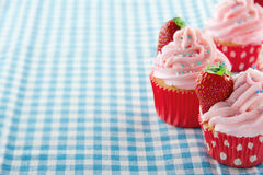 Cupcakes with strawberries and copy space Royalty Free Stock Photos