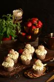Cupcakes with strawberries on a dark background. Still life royalty free stock photo