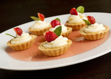 Cupcakes with strawberry, whipped cream, jelly and mint Royalty Free Stock Photo
