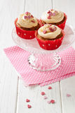 Cupcakes with sugar hearts Royalty Free Stock Photography
