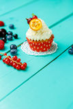 Cupcakes with summer berries Stock Photos