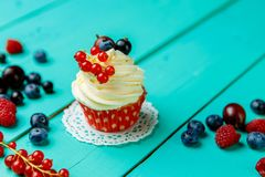 Cupcakes with summer berries Stock Photo