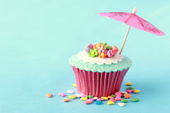 Cupcakes. Sweet cupcakes decorated with sugar paste and cream Royalty Free Stock Photos