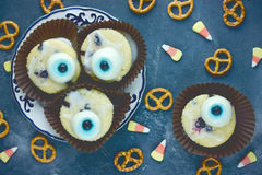 Cupcakes with sweet eyes on Halloween party Stock Photos