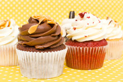 Cupcakes. Sweet cupcakes on yellow background royalty free stock image