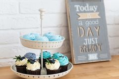 Cupcakes on the table with phrase enjoy it. Motivation. Dieting, healthy eating stock images