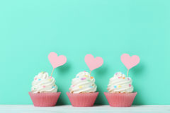 Cupcakes. Tasty cupcakes on a green background Stock Image