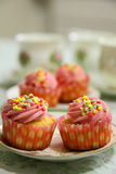 Cupcakes and tea Stock Images