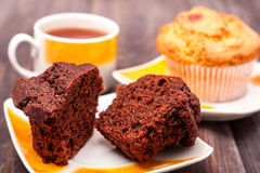 Cupcakes with tea on black wooden background Stock Photos