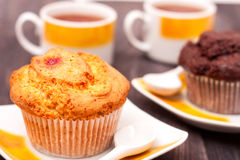 Cupcakes with tea on black wooden background Royalty Free Stock Image